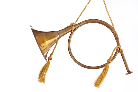 brass instrument: A brass gold color Christmas ornament French horn isolated on a white background in the horizontal format.
