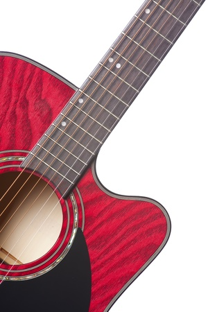 A red acoustic electric guitar isolated against a white background in the vertical format.