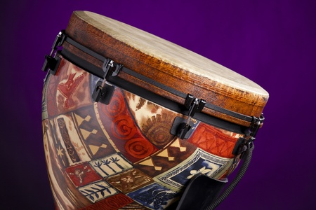 djembe drum: An African Latin djembe or conga drum isolated against a spotlight purple background. Stock Photo