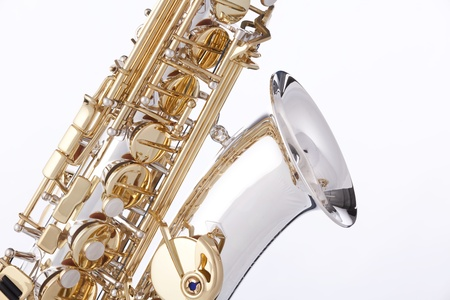 A professional saxophone isolated against a white background in the vertical format. Stock Photo