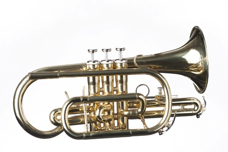 A gold brass cornet trumpet isolated against a white background in the horizontal format. Stock Photo