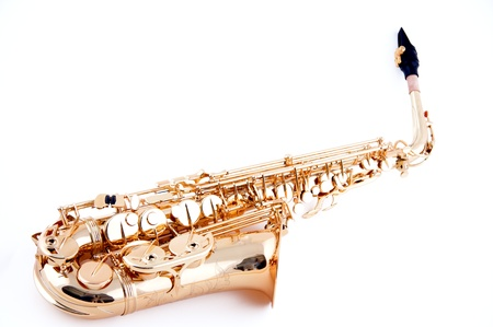 horizontal format horizontal: A gold brass saxophone isolated against a white background in the horizontal format. Stock Photo
