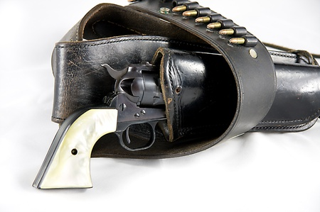 holster: An old western six gun revolver isolated against  a white background in the  horizontal format with copy space.