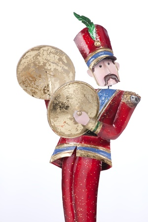 cymbals: A toy Christmas soldier musician playing cymbals isolated against a white background.