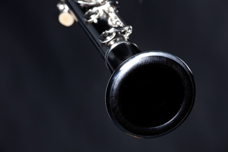 horizontal format horizontal: A soprano clarinet isolated against a black background in the horizontal format with copy space.
