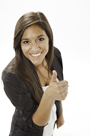 teen girl brown hair: An cute attractive smiling teenage female girl giving the thumbs up sign on a white background. Stock Photo