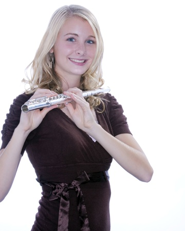silver flute: A blond blue eyed teenage female girl holding a silver flute against a white background.