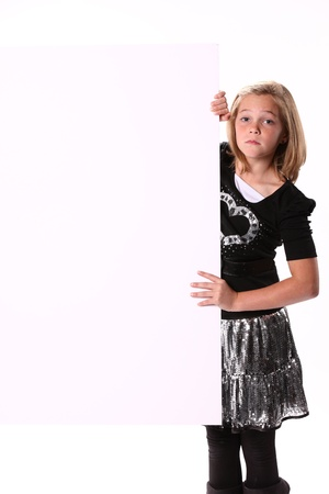 10 year old: Preteen 10 year old female attractive girl holding a white sign isolated against a white background.