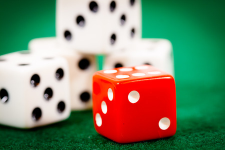 dealt: Four white dice with one red die in front