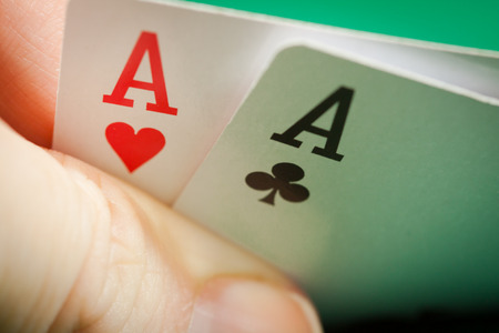 dealt: Two aces in a hand playing poker