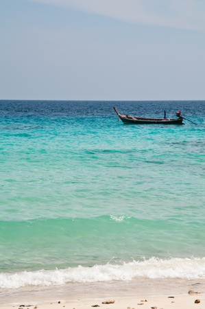 a boat on the sea of thailand photo