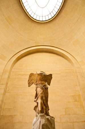 Goddess of victoria, sculpture in louvre museum photo