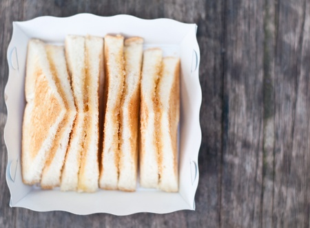 Bread toast with sugar and sweetened condensed milk on the paper tray photo