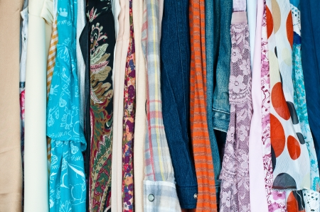 clothing rack: Colorful clothes choice of casual clothes Stock Photo