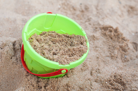 children bucket toy on the beach photo