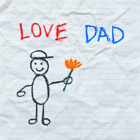 Drawing wording   Love Dad  with cartoon of boy on the crumpled paper photo