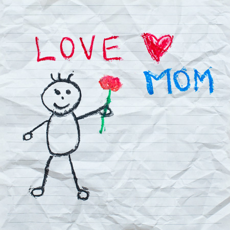 mather: Drawing wording   Love Mom  with cartoon of boy on the crumpled paper Stock Photo