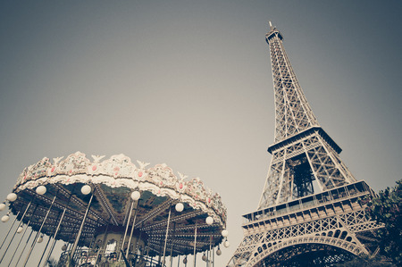 The Eiffel tower with the Carousel in Paris, France, vintage style photo