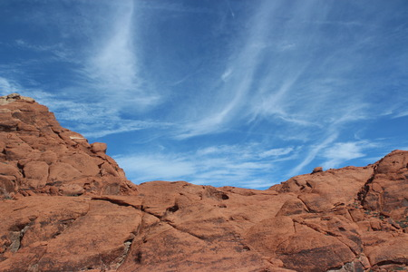 red mountain open space: A serene picture of the sky in a red rock canyon. Stock Photo