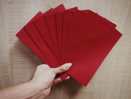 envelop: hand carry white envelop Stock Photo