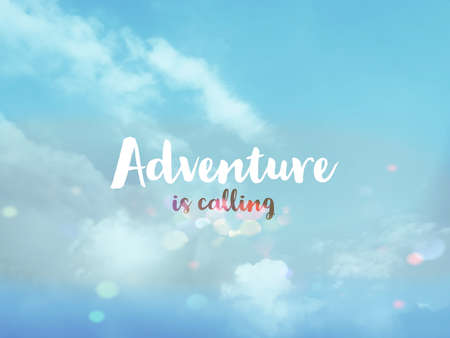 Adventure is calling word on pastel blue sky bokeh background