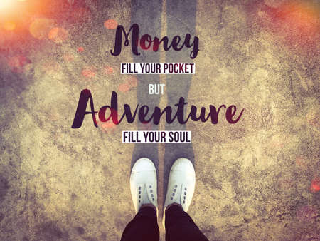 Money fill your pocket but adventure fill your soul word and white sneakers on background Stockfoto