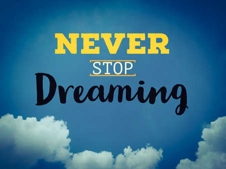 Never stop dreaming word on dark blue sky background Stockfoto