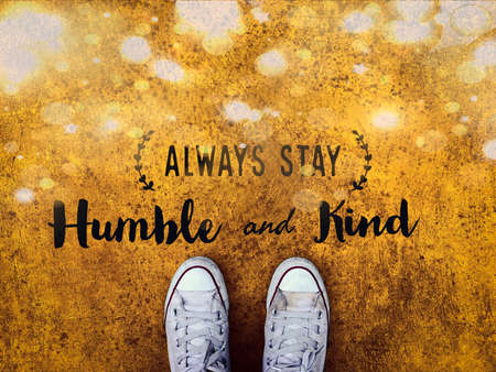 Always stay humble and kind word on white sneakers shoe yellow sparkle background