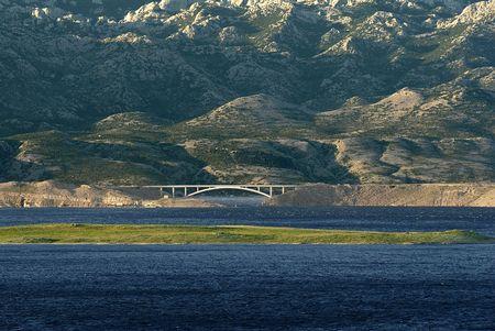 bridge, sea and mountains Stock Photo