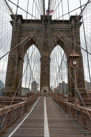 Landscape view of empty Brooklyn Bridge in New York City, empty streets due Covid-19 coronavirus pandemic, USA