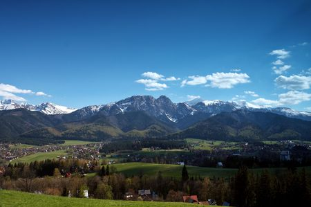 tatry: Mountain Landscape (Mt. Giewont) with view on a grass meadow and a town