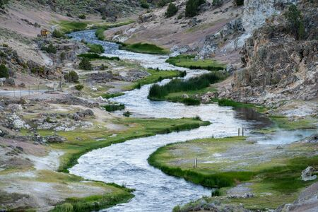 Close up view of the bubbling hot creek geological site in Mammoth Lakes California Фото со стока