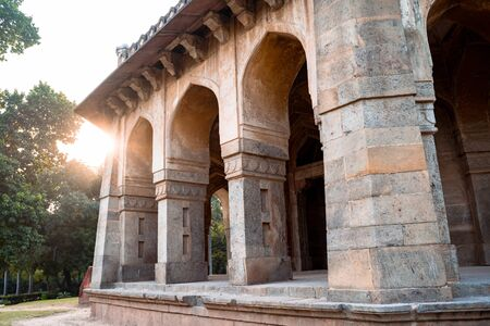 Muhammad Shah Sayyid Tomb in Lodi Garden in New Delhi India, with sunflare near the arches