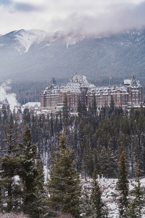 Banff, Alberta Canada - Jan 21, 2019: Winter scene view of the famous Fairmont Banff Springs Hotel, as seen from Surprise Corner in Banff National Park