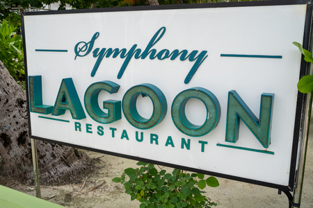 Maafushi, Maldives - November 25, 2019: Sign for the Symphony Lagoon Restaurant serving Multi Cuisine Family friendly food 스톡 콘텐츠 - 134992064