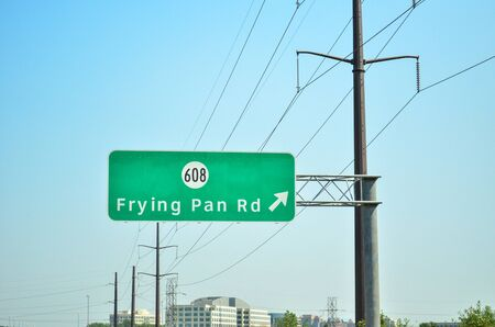 Herndon, Virginia - June 2, 2018: Sign for Frying Pan Road exit in Northern Virginia. Located in Fairfax County Stock Photo