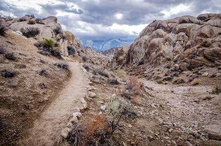 Trail through giant boulders to the Moibus Arch in Alabama Hills California, in the Eastern Sierra Nevada mountains