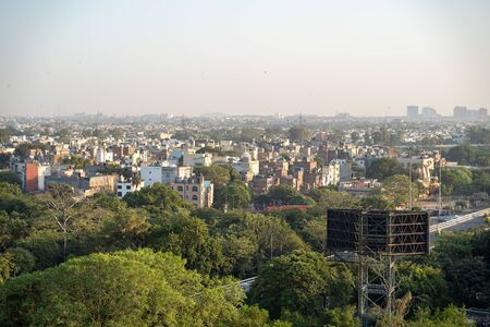 Cityscape birds eye aerial view of New Delhi India on a somewhat clear day.