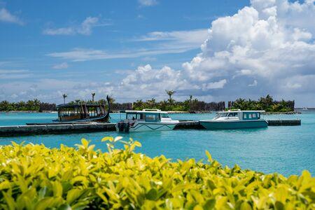 North Male Atoll, Maldives - November 23, 2019: Speedboats at a dock at the Sheraton Maldives Full Moon Resort wait for passengers