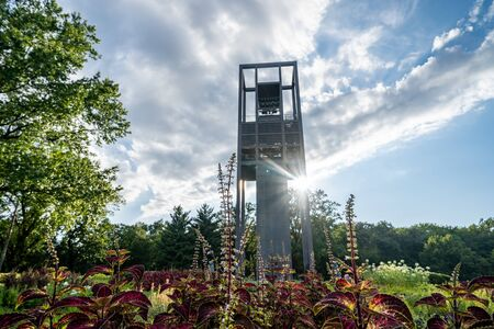 Washington, DC - August 7, 2019: Netherlands Carillon, a 127-foot tall steel tower in Arlington Ridge Park, with gardens and a sunflare