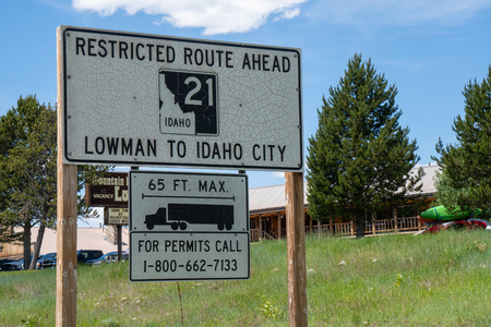 Stanley, Idaho - July 1, 2019: Sign warns drivers about a restricted route (Idaho Highway 21) from Lowman to Idaho City. No large trucks allowed Editorial