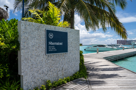 North Male Atoll, Maldives - November 23, 2019: Sign for the Sheraton Maldives Full Moon Resort and Spa luxury hotel on its own private island