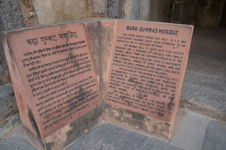 New Delhi, India - November 16, 2019: Informative sign for Bara-Gumbad Mosque, a tomb from the last lineage of the Lodhi Dynasty in Lodi Gardens