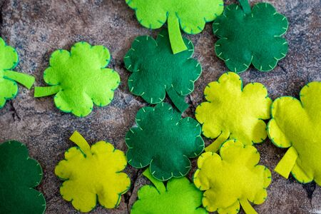 Lucky shamrocks, concept for St Patricks Day in March. Flatlay on marble background