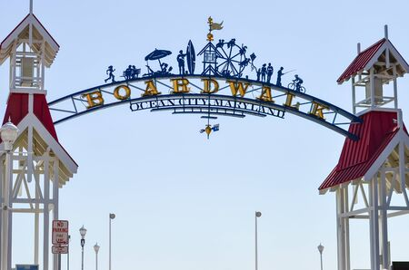 Ocean City, Maryland - April 3, 2018: Arch and welcome sign to the Ocean City Boardwalk on a sunny day. Boardwalk includes restaurants, shops and an amusement park