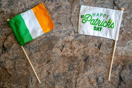 Happy St Patricks Day flag with an Ireland flag. Concept for St Patricks Day. Flatlay on marble background