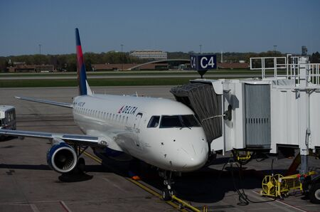 Minneapolis, MN - May 2 2018: A Delta Air Lines Delta Connection jet airplane waits at a gate at MSP International Airport for passengers