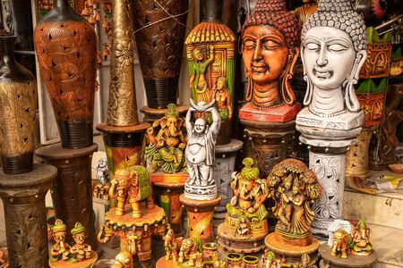 Variety of hindu and buddhism buddha statues and gods for sale at a market in New Delhi India