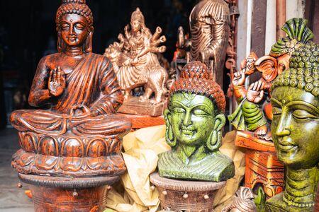 Religous buddah statues for sale at a home decor market in New Delhi India Reklamní fotografie