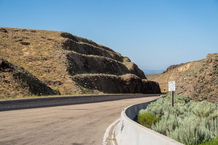 The steep grade of US-95 highway in Owyhee County Idaho through the canyon and mountains